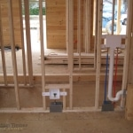Log home plumbing being set